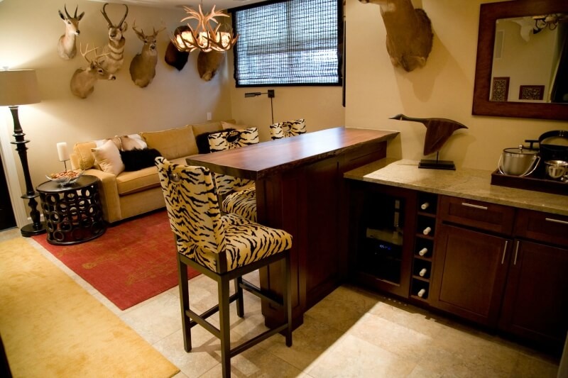 3-way-Man cave with built-in bar and mounted game animals on the wall