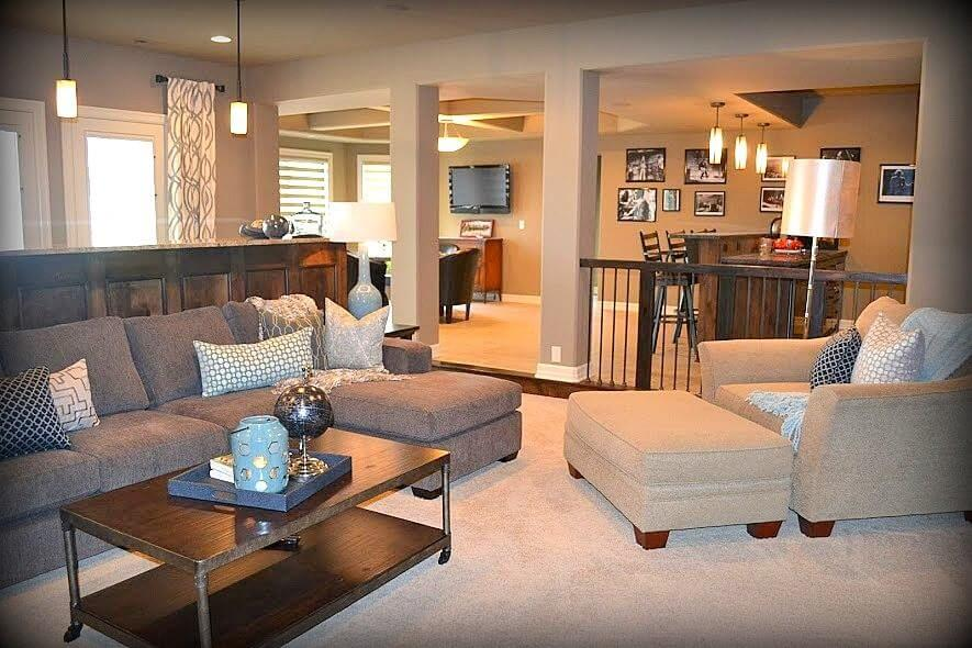 Panoramic view of this custom finished basement with large entertainment area, bar counter, card table and built-in bar.