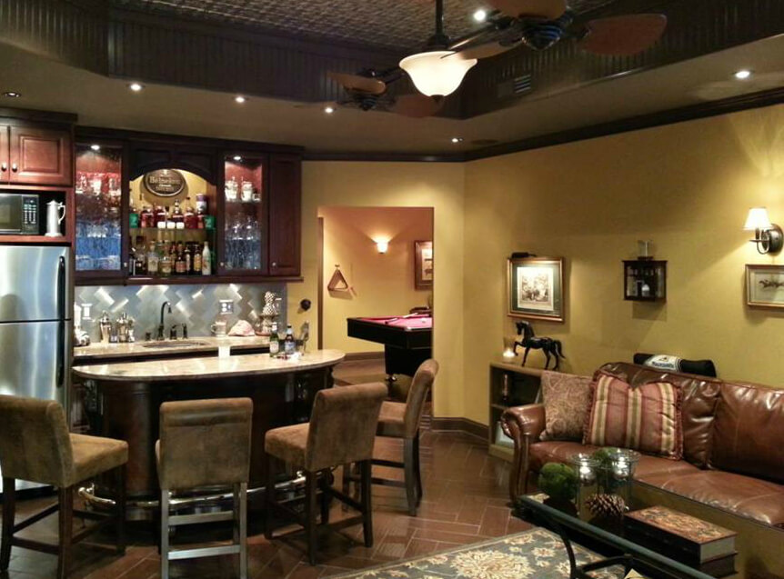 "This finished basement ""man cave"" uses space very well, yet it's not too crammed. It includes a comfortable sitting area, mini-bar/kitchenette and pool table."