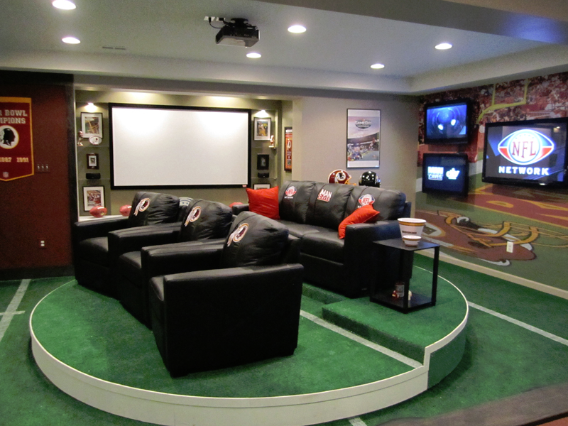 This is one of the most popular man cave concepts on our site. It's definitely a sports-themed man cave with some great TV viewing and seating