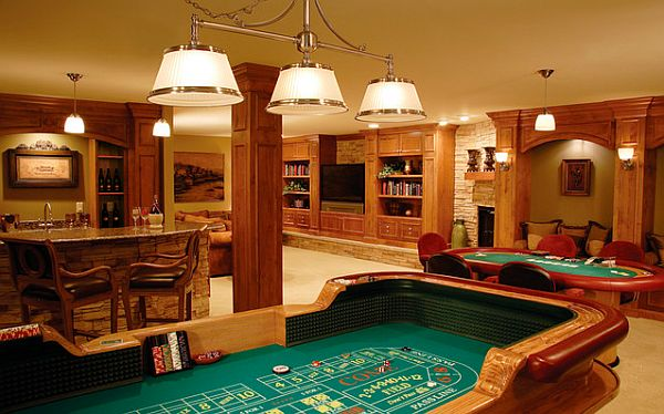 Here's a large finished basement with gambling tables, bar and entertainment area
