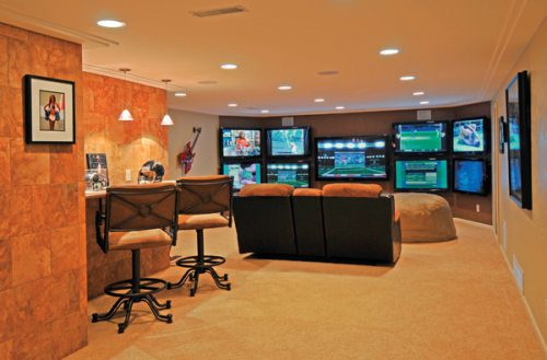 A finished basement for the avid sports fan who can watch up to 9 games at once on the 9 televisions
