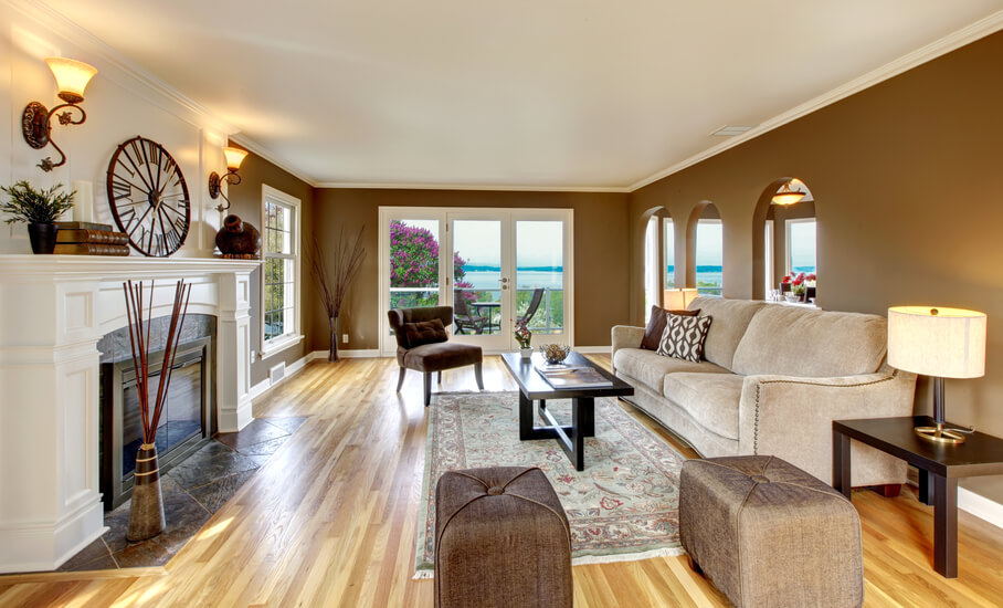 surround this living room with goldish brown furniture and carpeting