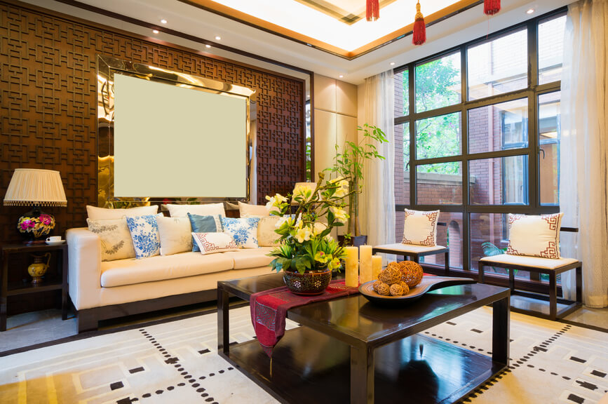Asian-inspired living room design with patterned floor, dark wood coffee table, floor-to-ceiling window, white sofa and dark brown patterned wall.