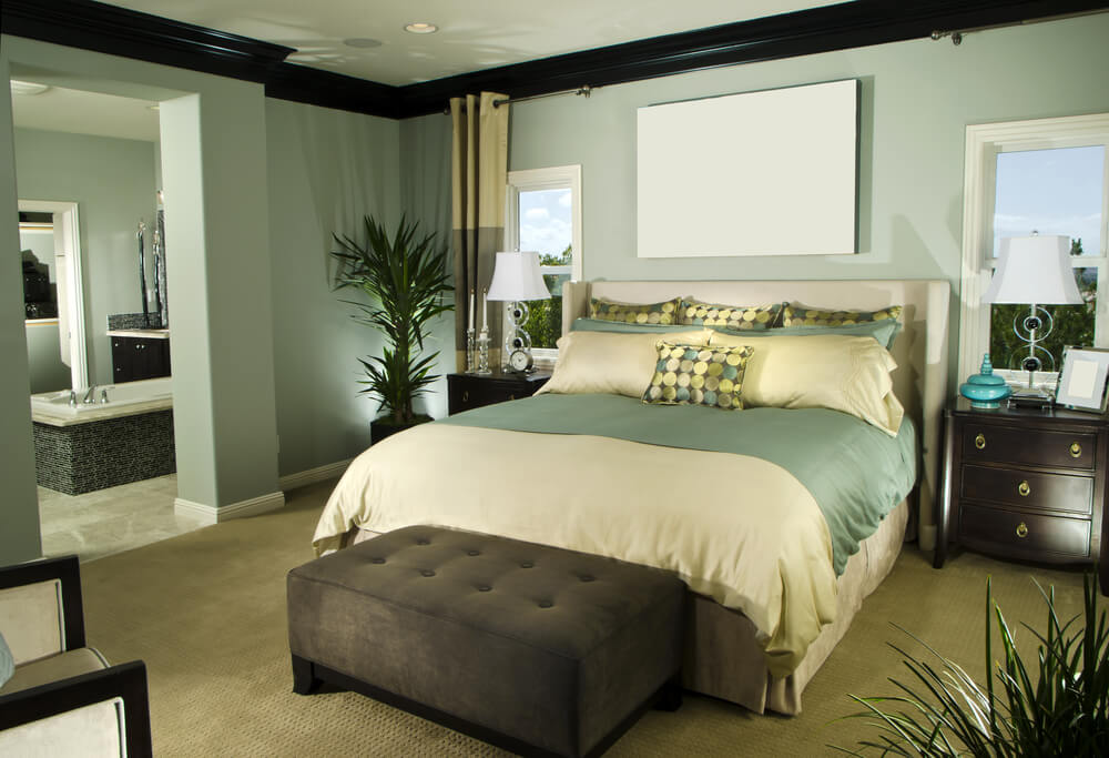 Small master bedroom in green, cream and brown color design