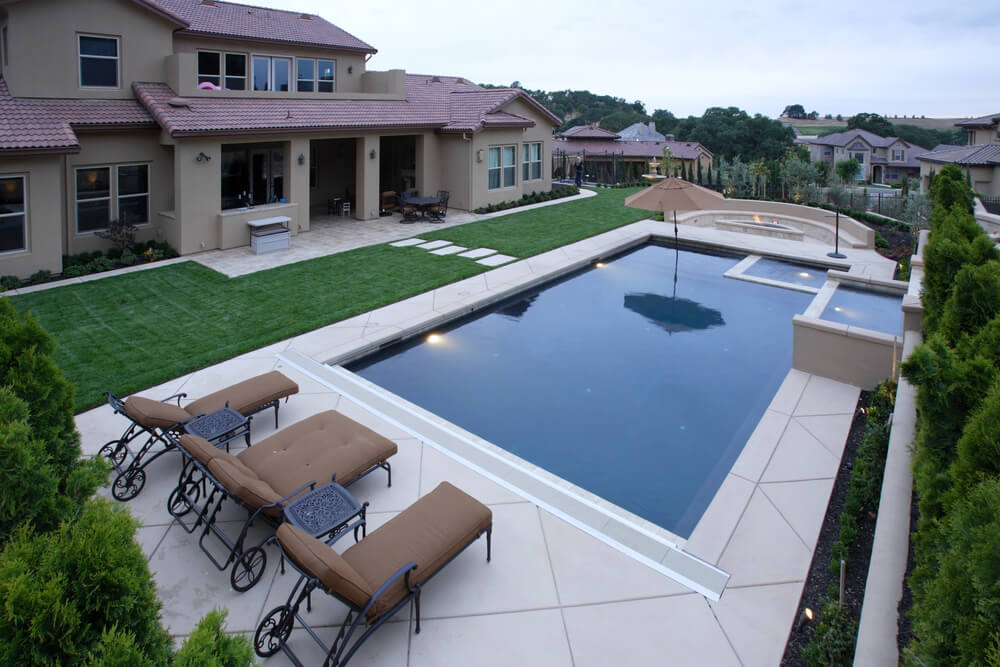 Backyard covered patios - Suburban Home With Modern Pool And Hot Tub As Well As Fire Pit On One