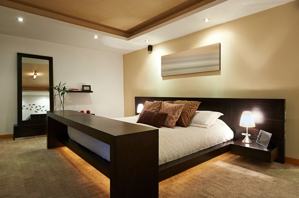 Minimally furnished bedroom make the large modern bed stand out