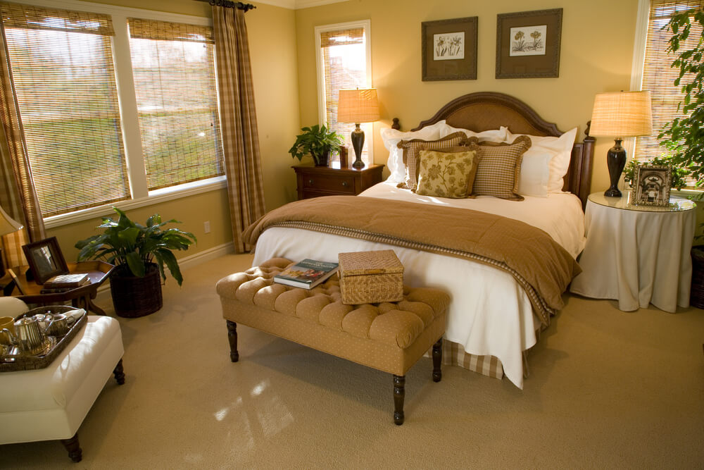 Soft brown, yellow and white make up the color scheme of this master bedroom