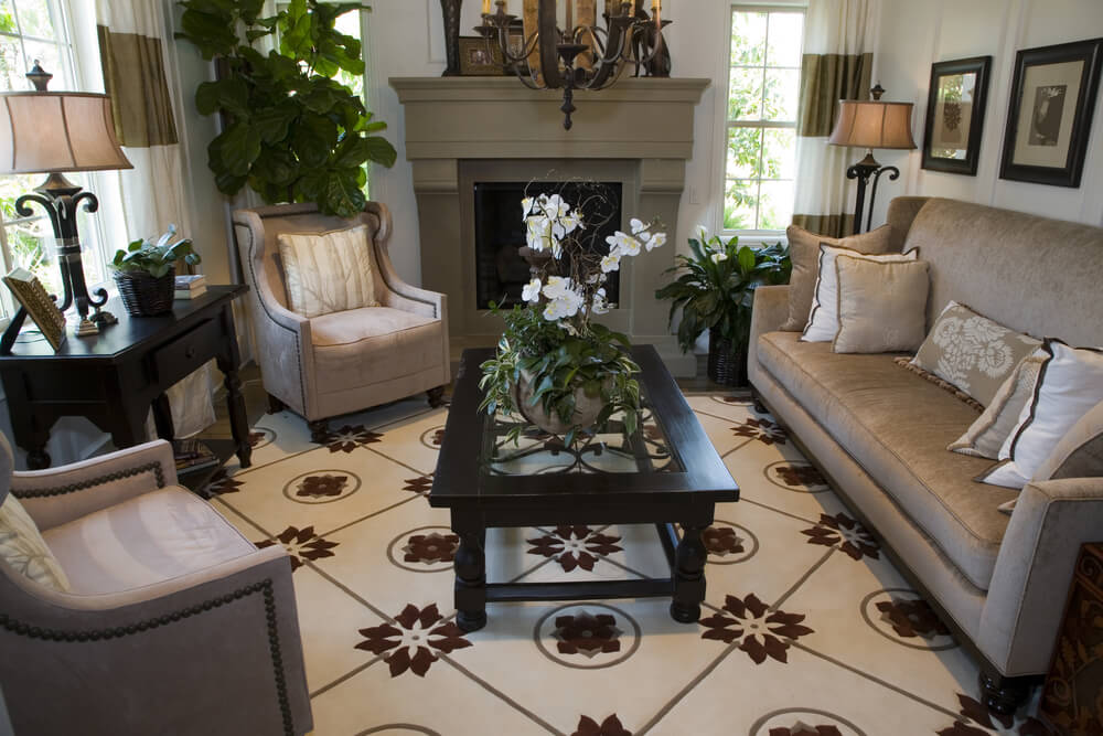 sandstone colored fireplace sits behind this living room centered