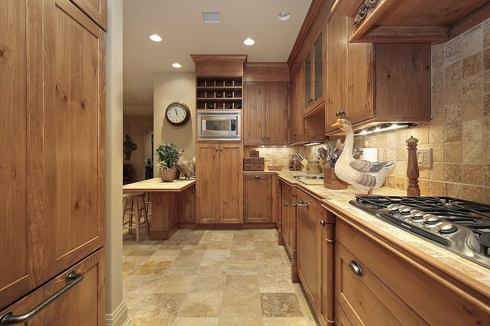 This White Kitchen Features Light Honey Hardwood Flooring And A Near Matching Island Countertop. photo - 6