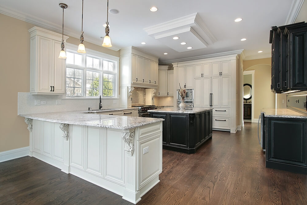 white cabinets and half black cabinets on dark wood floor with white