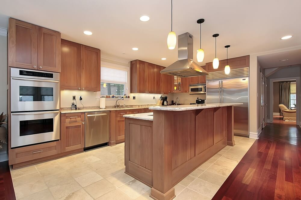 Shaped Wooden Kitchen Design On Tile Floor Surrounded By Wood Floor
