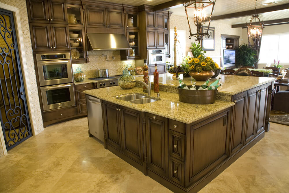 Two tiered wood and granite kitchen island makes this kitchen stand