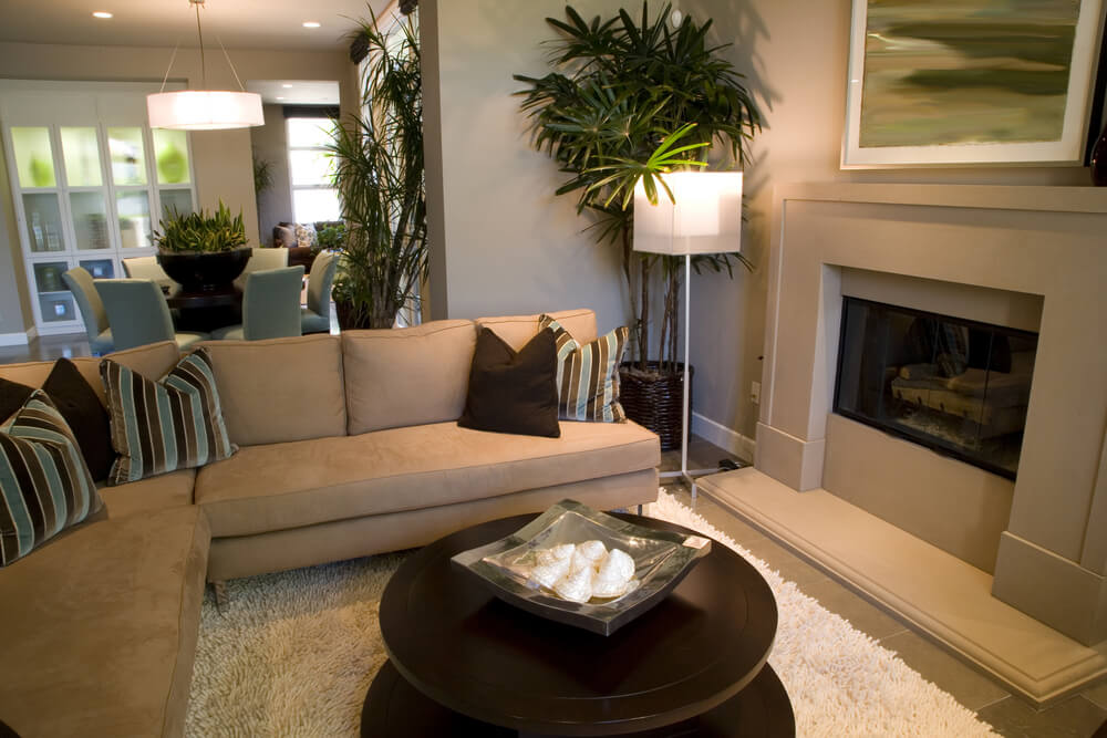 Another Cozy Space This One Defined By A Tan Leather L Shaped Couch