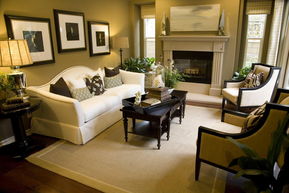 this living room with fireplace white sofa two armchairs dark wood