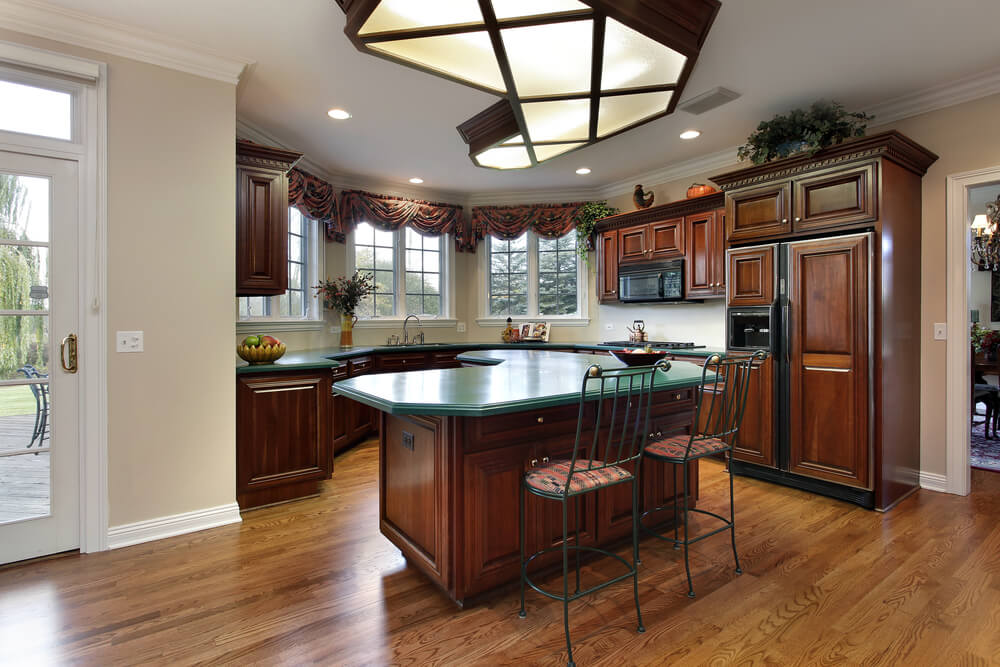 with unique cross hatch lighting design and forest green countertops