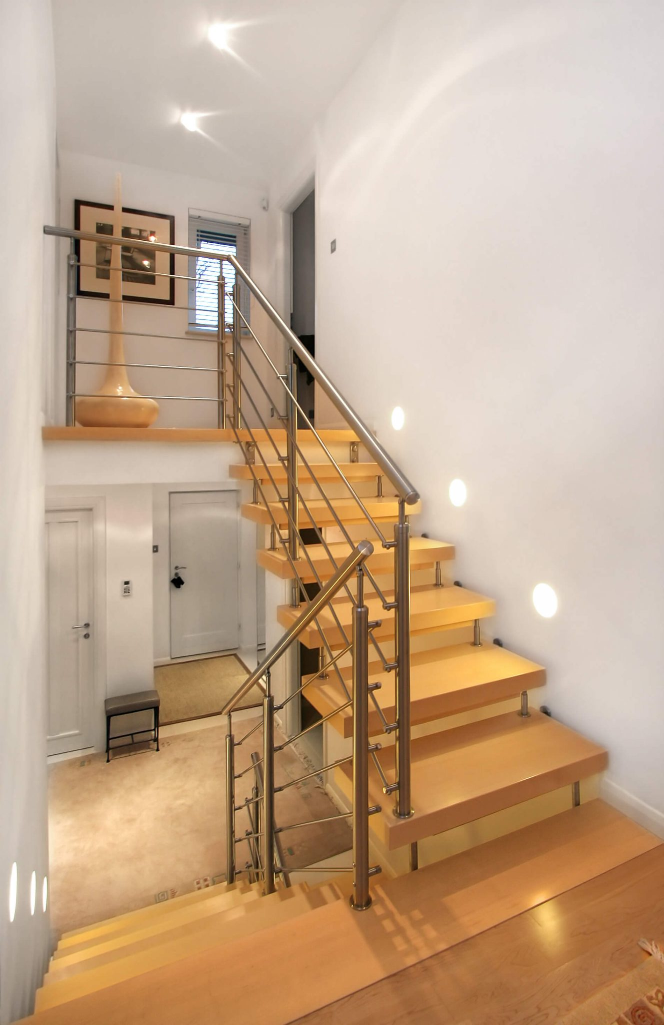 33 flamboyant modern staircase designs for Half spiral staircase