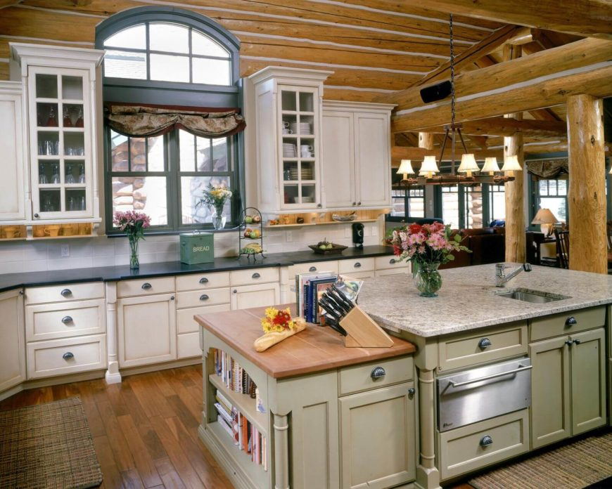 Rustic Theme Unifies This Kitchen Featuring Log Cabin Style Exposed
