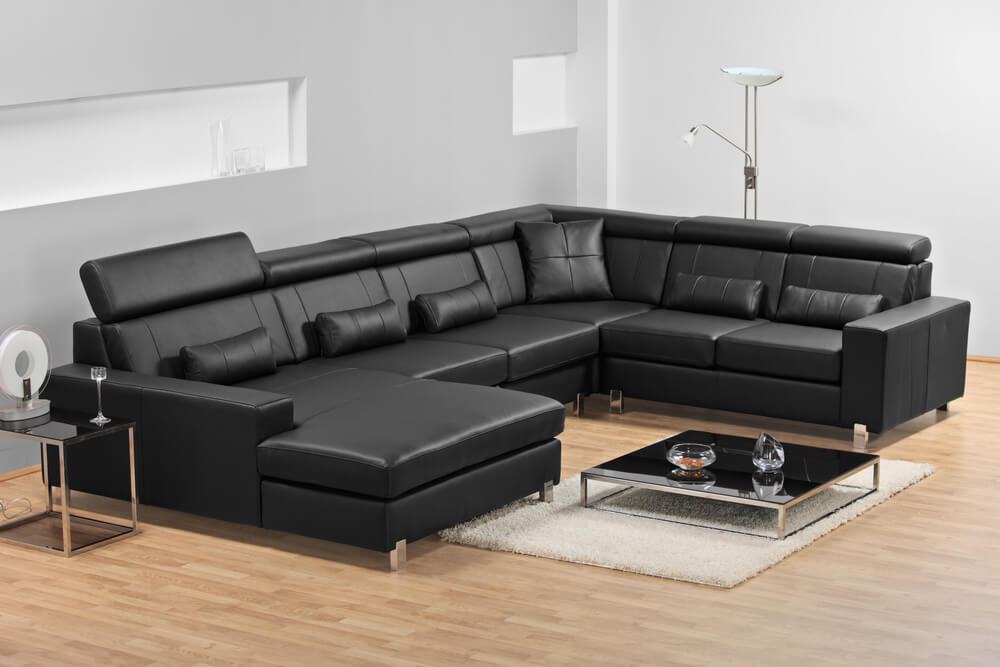 17 types of sofas couches explained with pictures for Sofas piel modernos