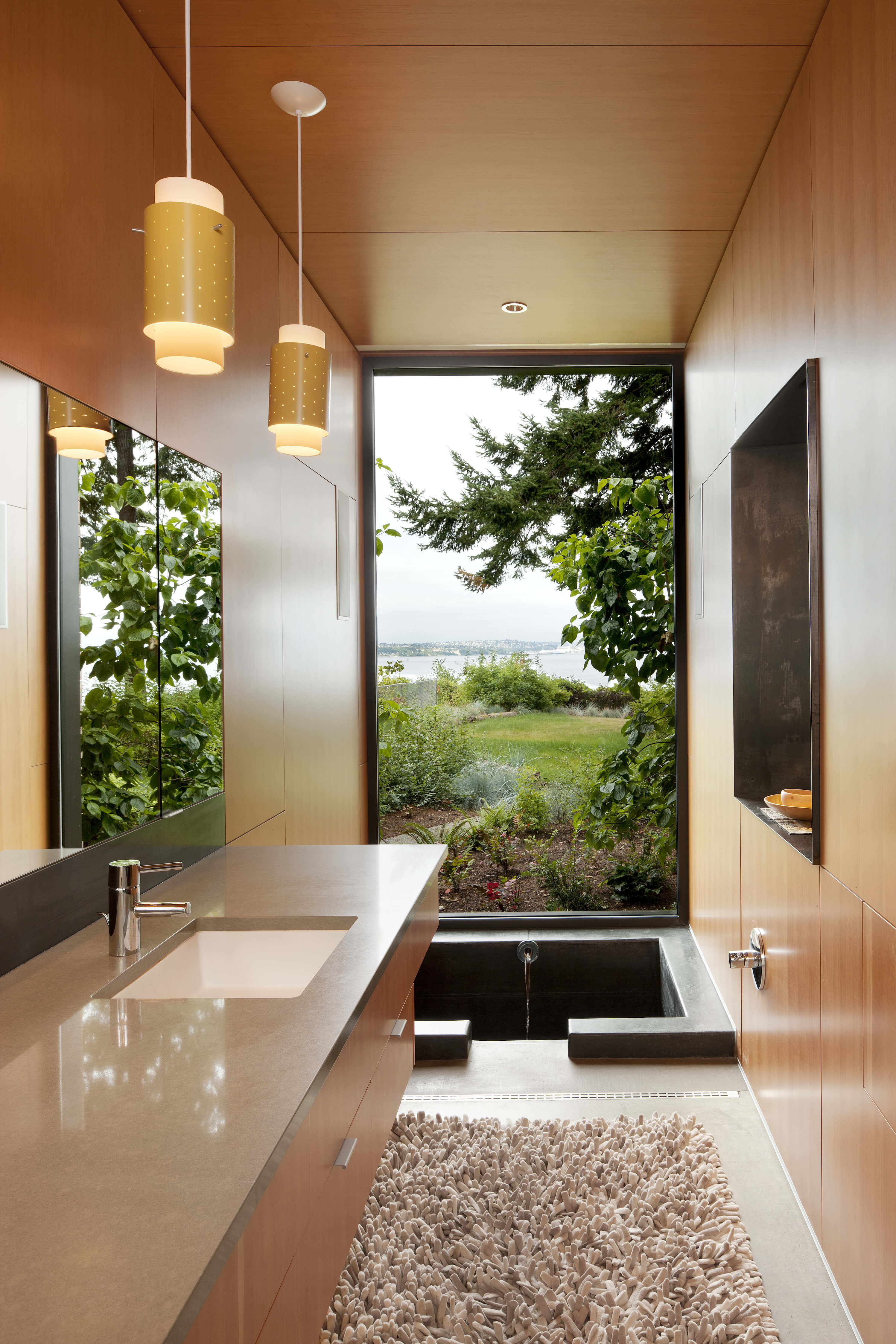 3 stunning modern home designs by coates design architects for Sunken bathtub