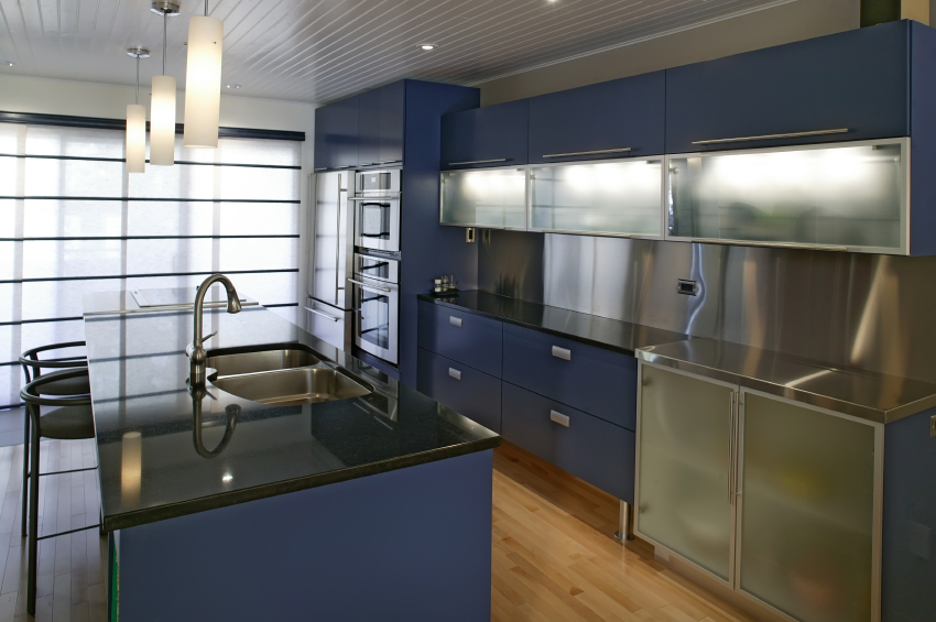 Bold color choice in this kitchen navy blue cabinetry over natural
