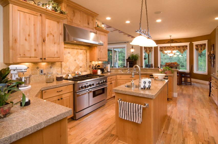 Singular Light Wood Tone Draws This Open Design Kitchen Together With