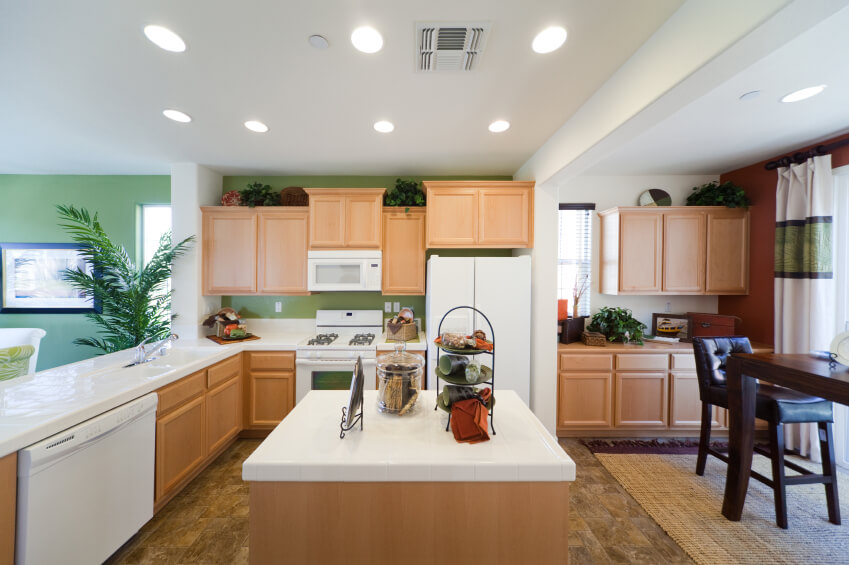Bright natural tones of green and wood lighten this open kitchen space