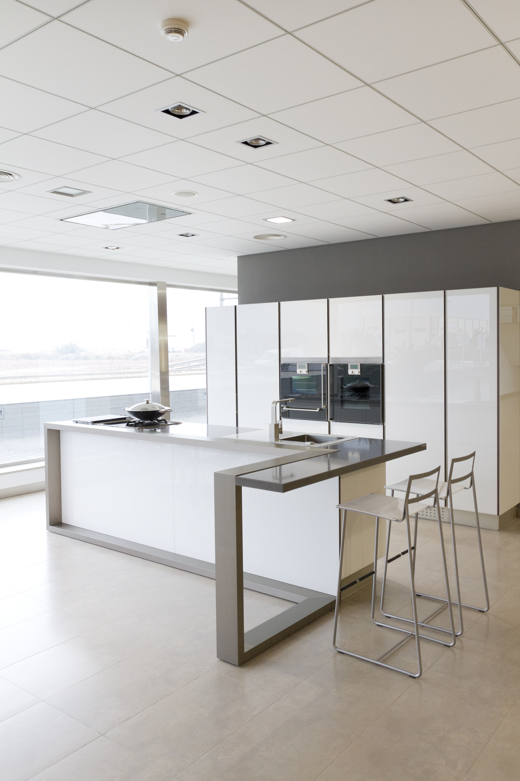 This kitchen features a similar contrast with light tile flooring and