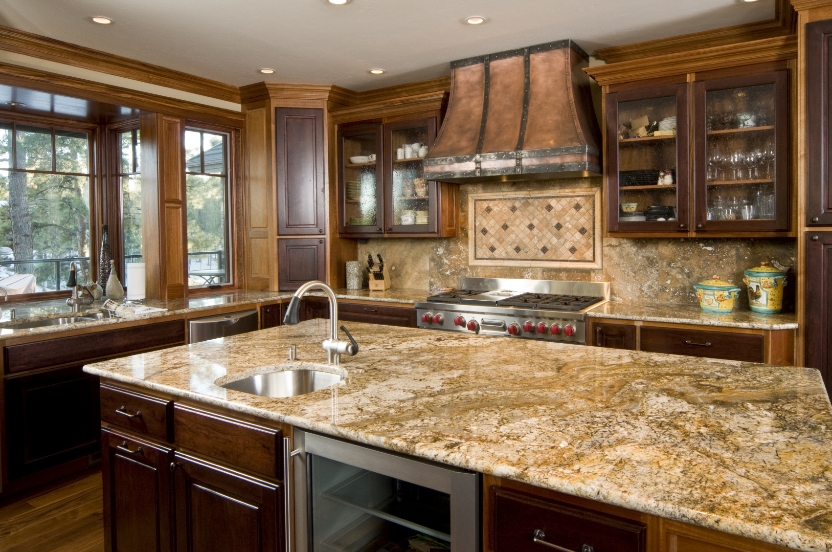 ... toned cabinetry, with mixed color marble countertops and backsplash