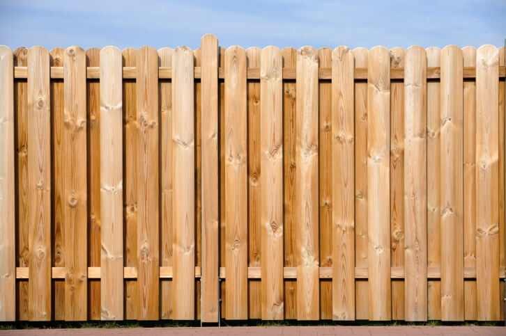 Wooden Fence Designs Ideas image of build horizontal wood fence This Wood Fence Design Layers Posts With Rounded Tops For A Fully Opaque Look