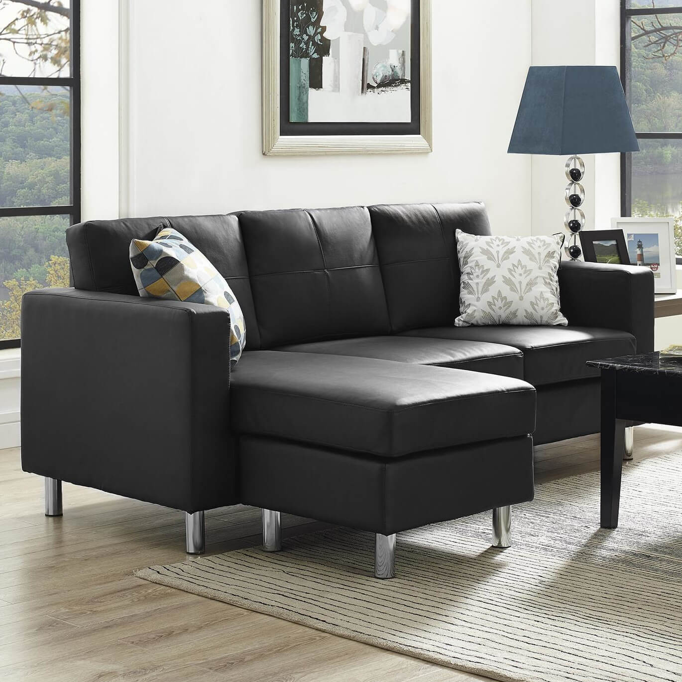 A Lovely Black Sectional With A Reversible Chaise. The Legs Are Aluminum,  And The Piece Is Upholstered In A Tailored Faux Leather In Black, ...
