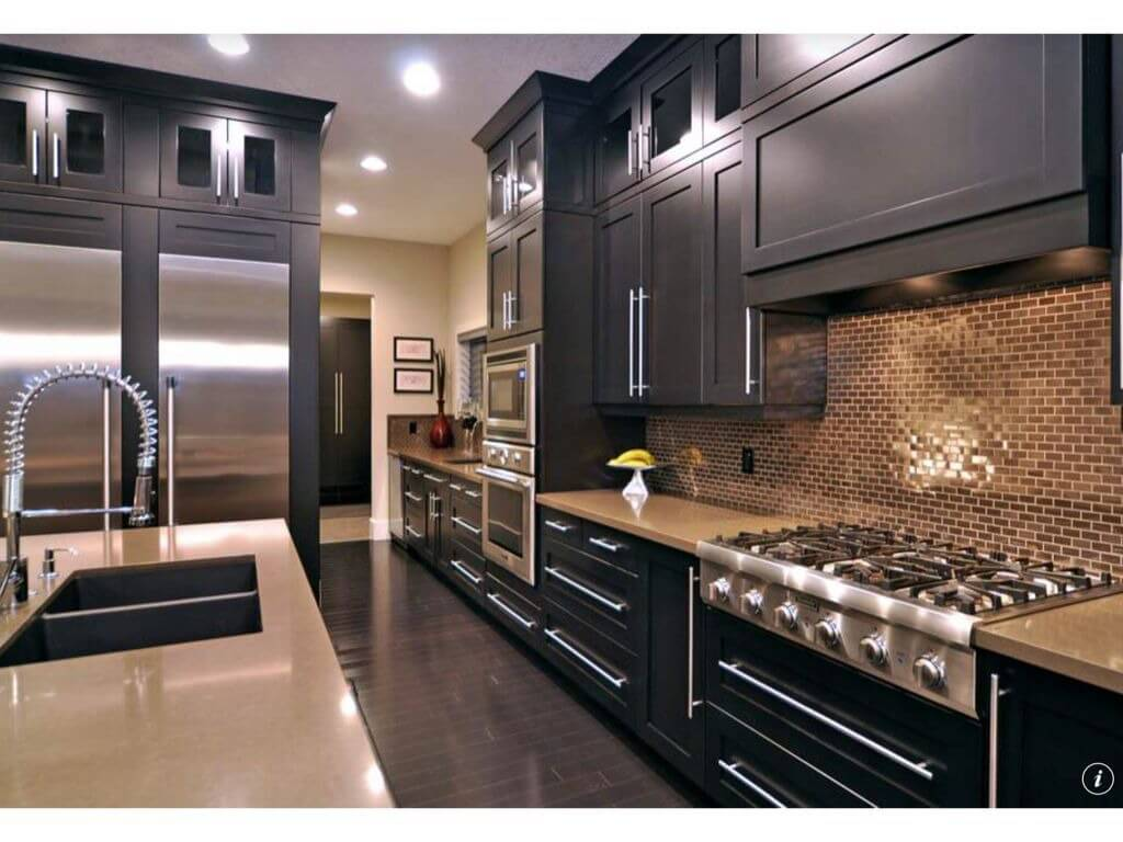 heres a dark galley kitchen thats relatively narrow and long