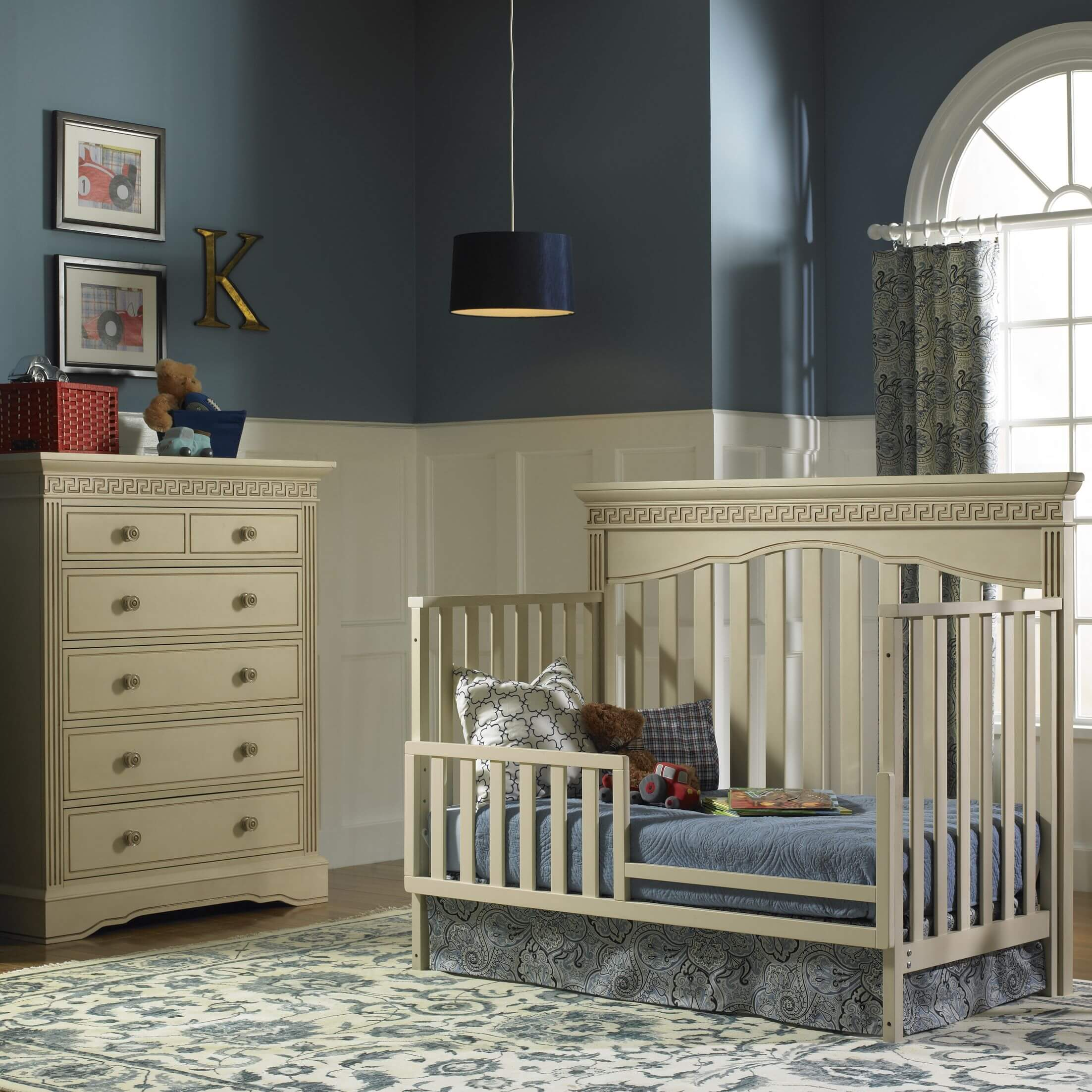 Dark subtle tones in this nursery include beige convertible crib and ...