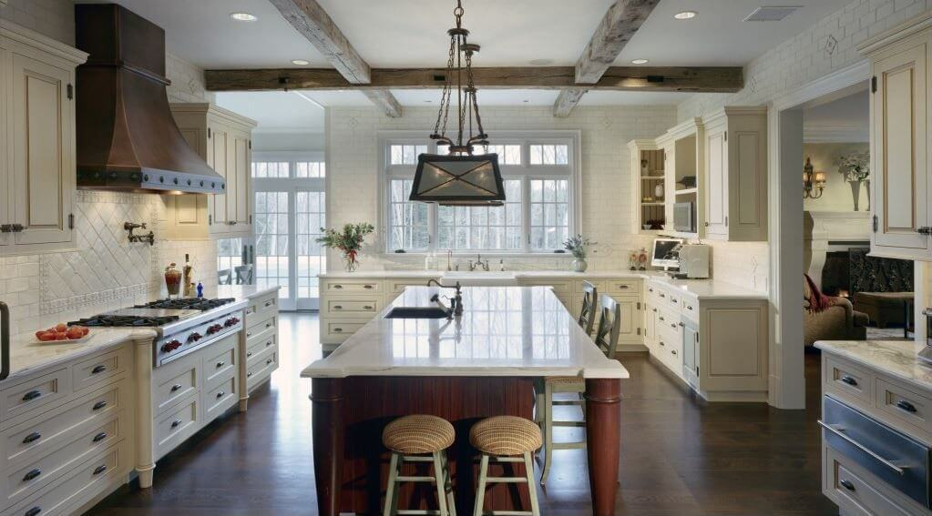 Large cherry wood island with white marble countertop dominates this ...