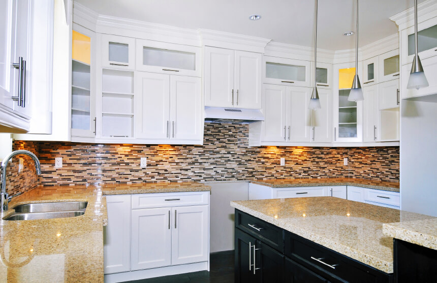 white cabinetry all around, patterned micro tile backsplash in earth