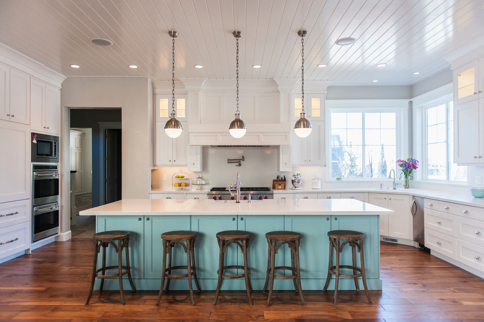 countertops, and large sky blue island over natural hardwood flooring
