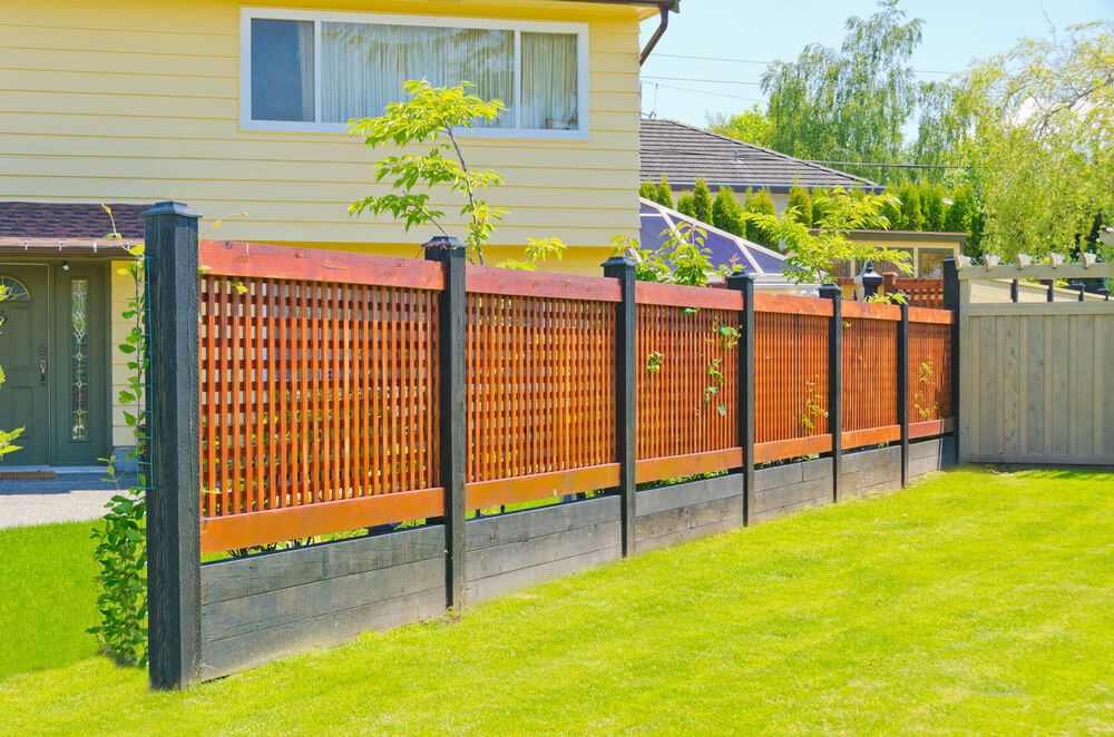 Wooden Fence Designs Ideas wood fence designs Modern Lattice Fence Comprised Of Black Stained Wood Posts And Base With Lighter Red Toned