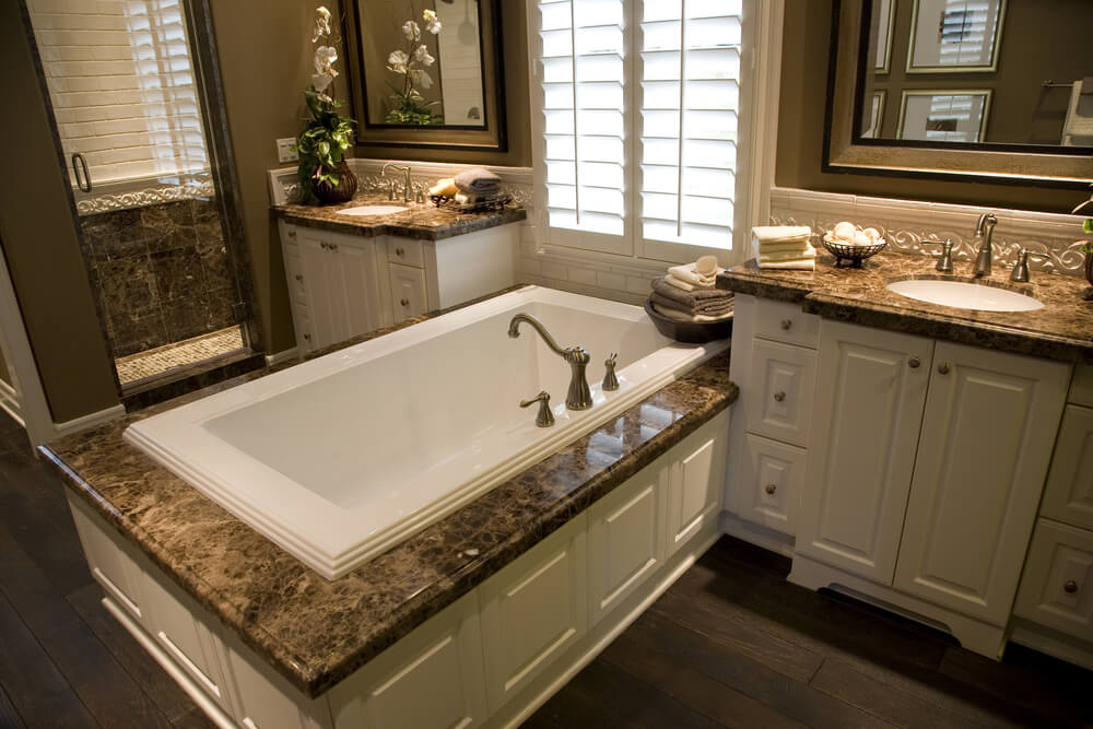 dark marble countertops over white wood cabinetry match the twin