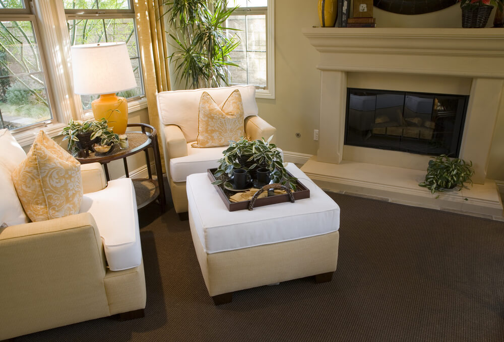 Living room beige bottoms with white cushions on chairs and matching