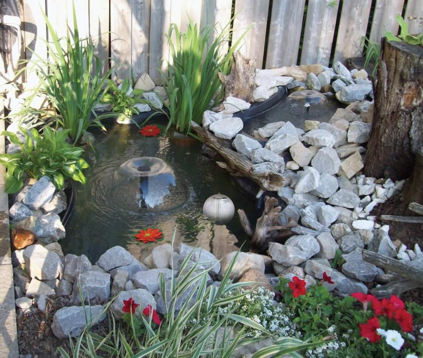 a small two section pond with a waterfall between the two both sections have - Koi Pond Designs Ideas