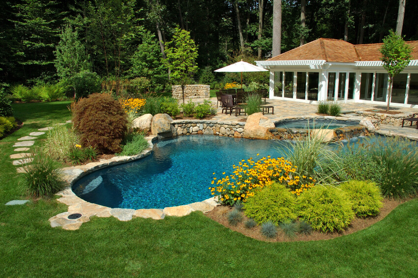 this lush back yard features a bold mixture of greenery and purposeful landscaping along with an. beautiful ideas. Home Design Ideas