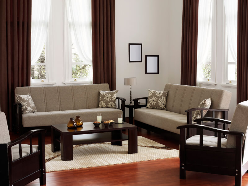 A Charming, Contemporary Living Room With Sleek Dark Wood Furniture On A  Warm Hardwood Floor