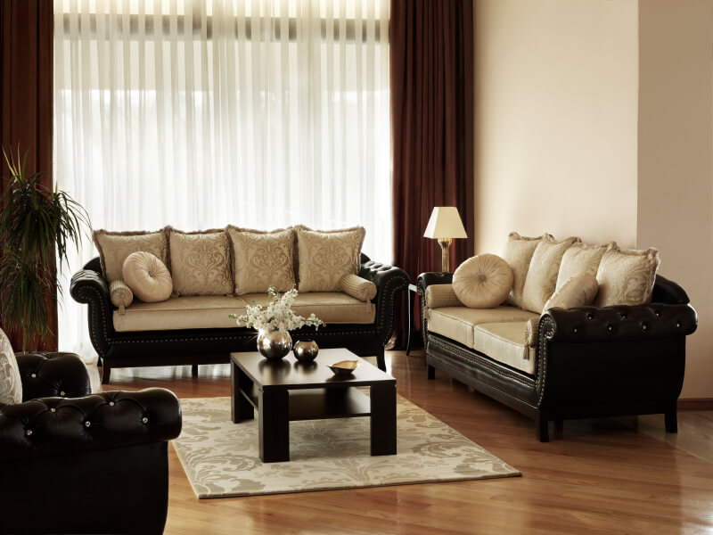 An Elegant Living Room With Button Tufted Sofas And Ornate, Luxurious  Cushions. The