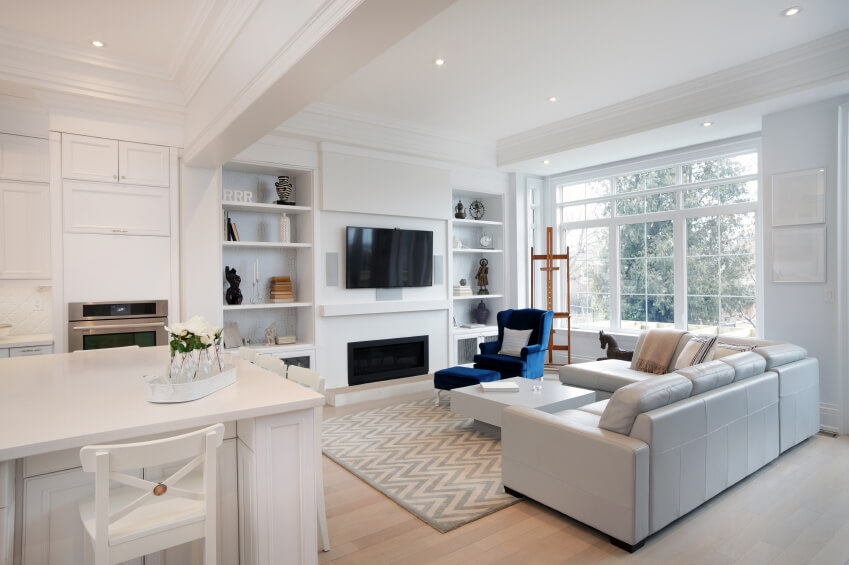 An Open Concept Living Room Dominated By White. The Adjacent Eat In Kitchen Part 90