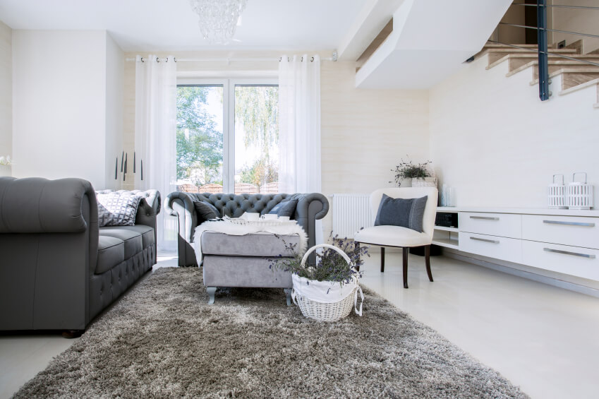 An Elegant Living Room In Dark Charcoal Gray And White, A Little More  Spacious Than