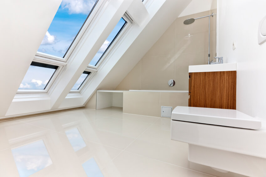 An all white bathroom with a slanted roof with plenty of windows  The  natural wood. 34 Attic Bathroom Ideas and Designs
