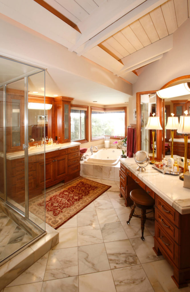 this opulent bathroom does not feature a traditional double sink vanity instead opting for a