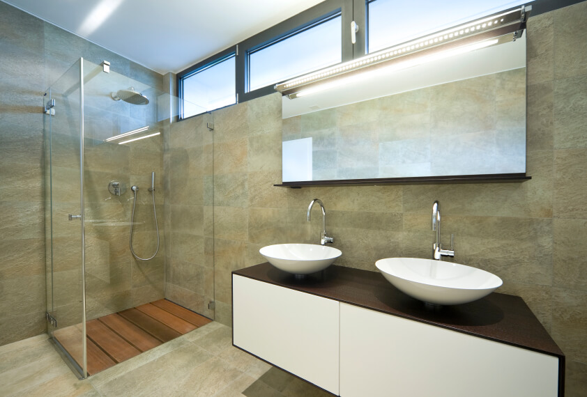 another view of the same bathroom reveals a lighted mirror simple standalone shower with cedar