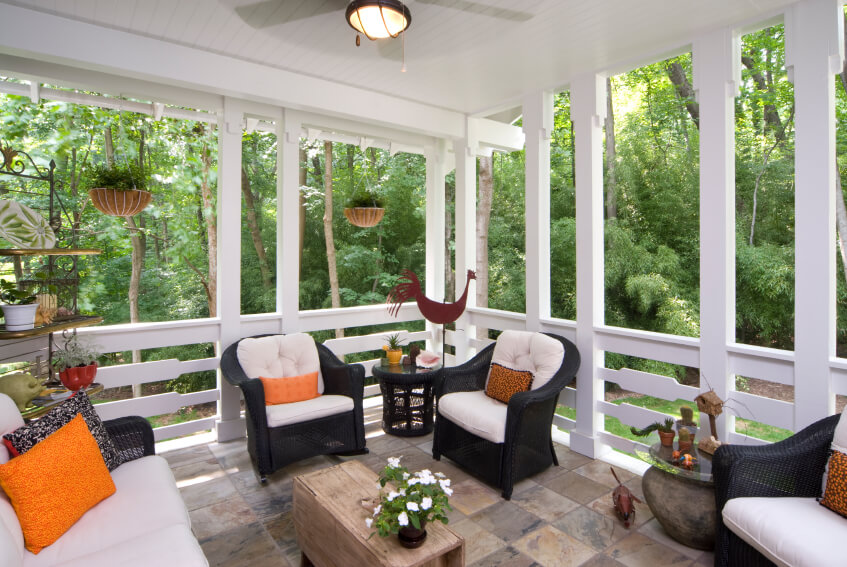this lovely white covered stone patio has country chic railings in between each support beam - Covered Patio Designs Pictures