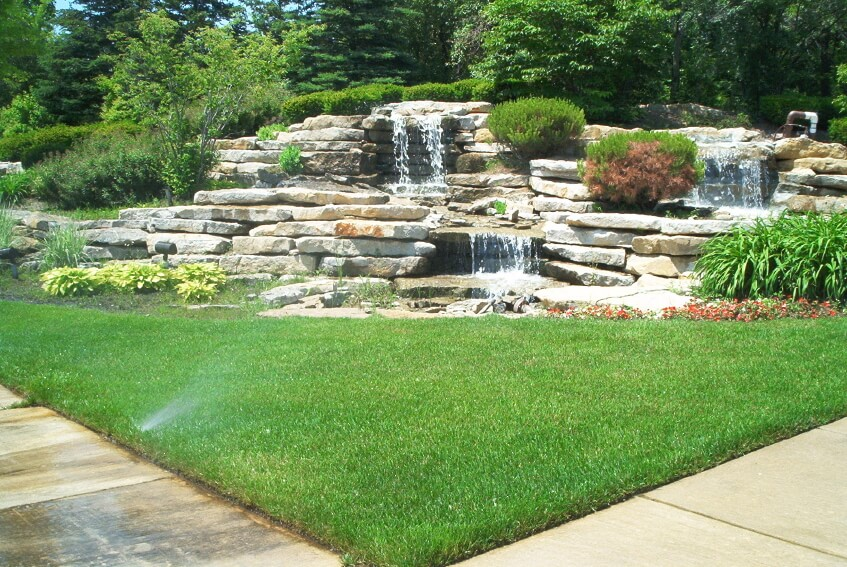 Waterfall Landscape Design Ideas backyard waterfall designs Layered Stone Waterfall In A Corner Of A Backyard